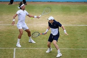 Andy Murray (right) and Feliciano Lopez in action in the Queen's Club doubles final on Sunday. The pair beat Rajeev Ram and Joe Salisbury 7-6 (8-6), 5-7, 10-5.