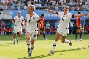 The United States' Megan Rapinoe (left) celebrates after scoring their second goal during the women's World Cup match against Spain in Reims, France, on June 24, 2019.