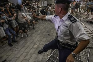A police officer uses pepper spray during clashes with protesters in Hong Kong on June 9, 2019.
