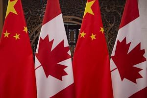 Canadian and Chinese flags arranged prior to a meeting between Canada's Prime Minister Justin Trudeau and China's President Xi Jinping in Beijing.