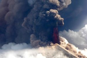 A pilot for Niugini Helicopters flying near the crater witnessed a column of lava spurting vertically into the equatorial sky, along with ash that has been belching since early morning on June 26, 2019.