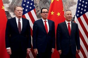 (From right) Chinese Vice Premier Liu He poses with US Treasury Secretary Steven Mnuchin and US Trade Representative Robert Lighthizer in Beijing, on May 1, 2019.