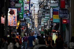 People walking in Osaka, Japan, where G-20 leaders are set to meet on Friday (June 28).