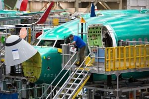 Employees work on Boeing 737 Max planes at the Boeing Factory in Renton, Washington.
