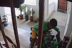 Closed-circuit television footage shows the man looking around before he picks up a pair of shoes from a shoe rack, puts it into an insulated food delivery bag and drives away on his personal mobility device.