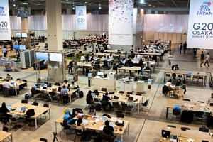 Journalists at the International Press Centre of the G-20 summit in Osaka on June 27, 2019.