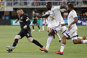 Ex-Manchester United star Wayne Rooney hammered a 68-yard strike over the head of Orlando goalkeeper Brian Rowe and into the back of the net in the 10th minute.
