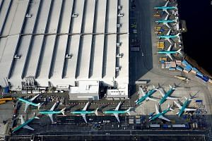 Boeing's 737 Max airplanes parked on the tarmac at the Boeing factory in Renton, Washington. The US planemaker must address the new safety issue - discovered during a simulator test last week - before the jet, which was grounded in March in the wake