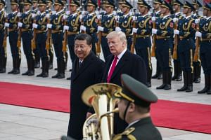 Presidents Xi Jinping (left) and Donald Trump will meet at the G-20 meeting in Osaka to get derailed trade negotiations back on track.