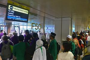 Muslims preparing to depart for Jeddah, Saudi Arabia, to perform the annual haj pilgrimage to the holy city of Mecca, at Changi Airport Terminal 2 on Sept 5, 2016.
