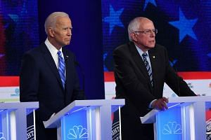 Democratic presidential hopefuls Joe Biden and Bernie Sanders speak during the second Democratic primary debate of the 2020 presidential campaign season at the Adrienne Arsht Centre for the Performing Arts in Florida, on June 27, 2019.