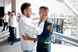 Neymar chatting with former Barcelona and Paris St-Germain teammate Dani Alves, who replaced him as Brazil captain for the Copa America, at the team hotel in Sao Paulo last week. Injured Neymar is angling for a move away from the French club and retu