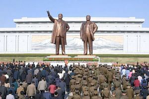 People offering flowers at the statues of late North Korean leaders Kim Il Sung and Kim Jong Il at the Mansu Hill Grand Monument in Pyongyang, on April 15, 2019.