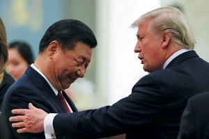 China's President Xi Jinping (left) greeting US President Donald Trump at the Great Hall of the People in Beijing, China, on Nov 9, 2017.