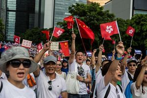 Demonstrators rallying in support of the city's police outside the Legislative Council building in Hong Kong on June 30, 2019.