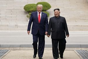 US President Donald Trump and North Korean leader Kim Jong Un talking at the demilitarised zone separating the two Koreas, in Panmunjom, South Korea, on June 30, 2019.