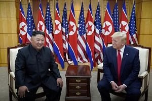 US President Donald Trump and North Korean leader Kim Jong Un meeting at the demilitarised zone separating the two Koreas, in Panmunjom, South Korea, on June 30, 2019.