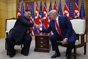 US President Donald Trump with North Korean leader Kim Jong Un yesterday at the Freedom House on the southern side of the truce village of Panmunjom in the Demilitarised Zone (DMZ), which separates the two Koreas. PHOTO: DPA