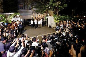 Indonesia's President Joko Widodo and his running mate Ma'ruf Amin greeting the press outside the latter's house in Jakarta last Thursday, after the Constitutional Court ruled to uphold the results of the vote that handed the incumbent president a se
