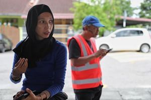 Housewife Azalila A Samad (left) is upset with the authorities' inability to resolve the situation.