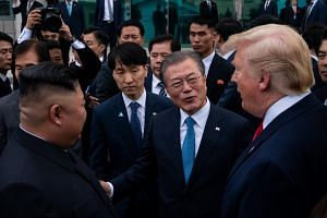South Korean President Moon Jae-in (centre) was instrumental in brokering the landmark summit between Mr Trump and Mr Kim in Singapore last year.