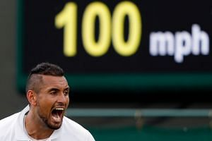 Kyrgios reacts during his first-round match against Jordan Thompson.
