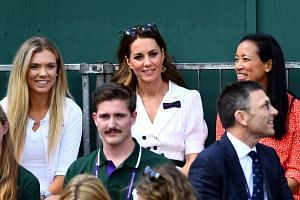 Kate (centre) sitting in the stands with Katie Boulter (left) and Anne Keothavong.