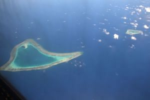 A 2017 image shows an aerial view of reefs in the disputed Spratly Islands, in the South China Sea.