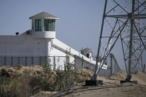 Watchtowers in a high-security facility near what is believed to be a re-education camp where mostly Muslim ethnic minorities are detained, in Xinjiang, China.