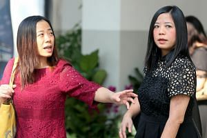 Tang Lei (left) and her sister Tang Bei outside the court on Aug 28, 2018.