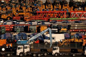 Newly manufactured vehicles await export at a port in Yokohama, Japan.
