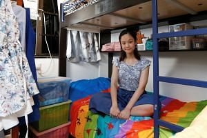 Primary school teacher Eunice Wai, 30, poses for a picture in her family's apartment in Hong Kong, on June 25, 2019.