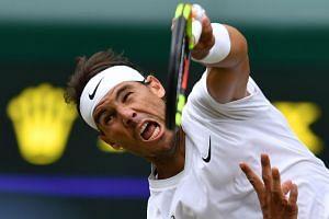 Nadal serves against France's Jo-Wilfried Tsonga.