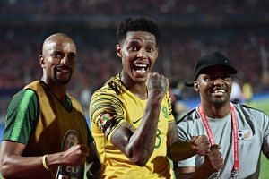 South Africa's players celebrate their win.