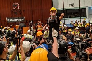 The protesters broke into the Parliament chambers of the Legislative Council building, organising themselves into groups, some helping with logistics or serving as medics, while others provided reinforcements to those on the front line.