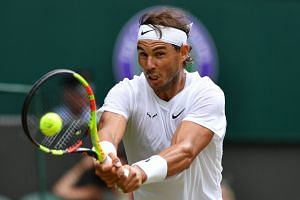 Nadal returns against France's Jo-Wilfried Tsonga during their men's singles third-round match.