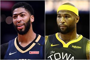 The Los Angeles Lakers have announced the signings of Anthony Davis (left) and DeMarcus Cousins.