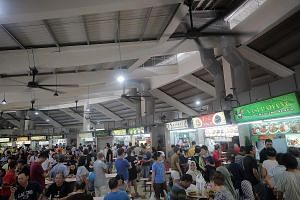 The newly reopened Tampines Round Market and Food Centre has wider walkways, energy-conserving lamps, better ventilation and high-volume, low-speed ceiling fans. ST PHOTOS: JASON QUAH