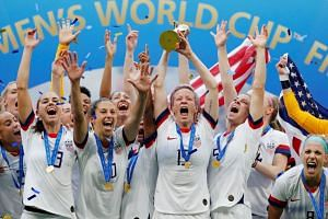 The US women's football team celebrate winning the Women's World Cup for the fourth time.