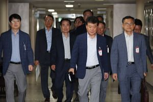 Officials from South Korea's semiconductor industry attend an emergency meeting on Japan's restrictions on exports to South Korea.