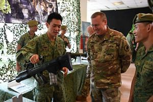 BG Lee Yi-Jin (left) sharing more about the SAR21 with BG Arthur J. Logan during a static display for Exercise Tiger Balm 2019.
