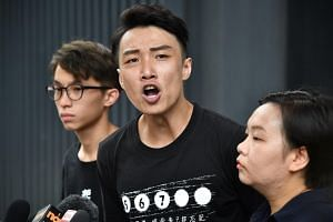 (From left) Figo Chan, Jimmy Sham and Bonnie Leung from HK Civil Human Rights Front respond to Carrie Lam's press conference on July 9, 2019.