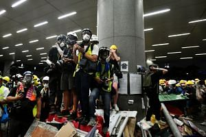 Members of media among the protesters outside the Legislative Council complex, on July 1, 2019.