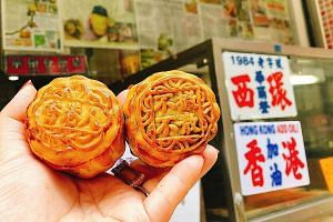 "Mooncakes from the Wah Yee Tang Cake Shop that read ""Hong Kongers"" (left) and ""No withdrawal, no dispersal""."