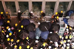 Protesters smashing the glass panels of the Legislative Council building on July 1. Underlying the frustration that fuels the demonstrations is the loss of confidence of many Hong Kong youth in their future, says the writer. ST PHOTO: LIM YAOHUI