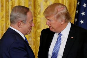 Trump (right) greets Netanyahu at the White House in 2017.