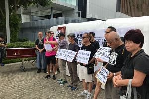 A group of protesters outside Hong Kong Chief Executive Carrie Lam's office on July 12, 2019.