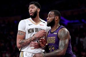 According to multiple reports, LeBron James (right) did not file an official request to change numbers with teammate Anthony Davis (left) before the March 15 deadline, and Nike, the league's official outfitter, preferred not to make an exception due
