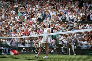 Romania's Simona Halep celebrates winning against Serena Williams at the Wimbledon women's singles final.
