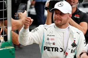 Mercedes' Valtteri Bottas will start the British Grand Prix from pole position after edging out current championship leader Lewis Hamilton.